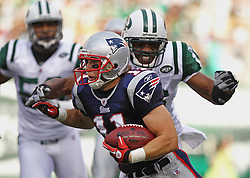 Sept 19, 2011; East Rutherford, NJ, USA; New England Patriots wide receiver Julian Edelman (11) tries to avoid a tackle by New York Jets wide receiver Brad Smith (16) during the 1st half at the New Meadowlands Stadium.  Mandatory Credit: Ed Mulholland-US PRESSWIRE