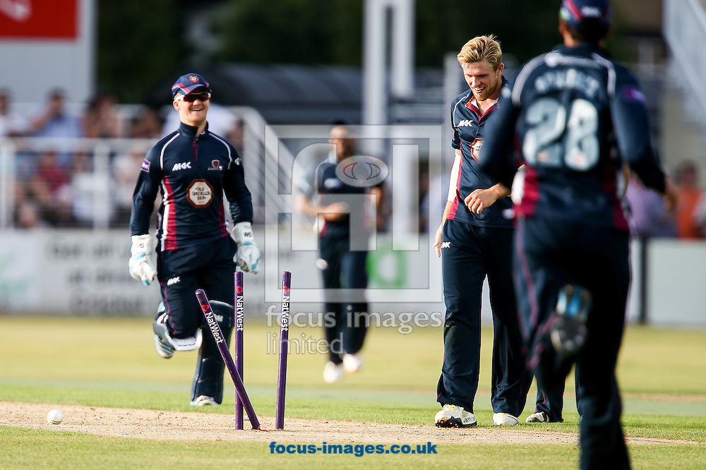 David Willey of Northants Steelbacks (centre) is all smiles after running out Chris Munro of Worcestershire Rapids (not shown) during the Natwest T20 Blast match at the County Ground, Northampton<br /> Picture by Andy Kearns/Focus Images Ltd 0781 864 4264<br /> 18/07/2014