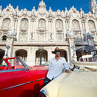 Taxi driver next to his vintage car in Havana, Cuba.