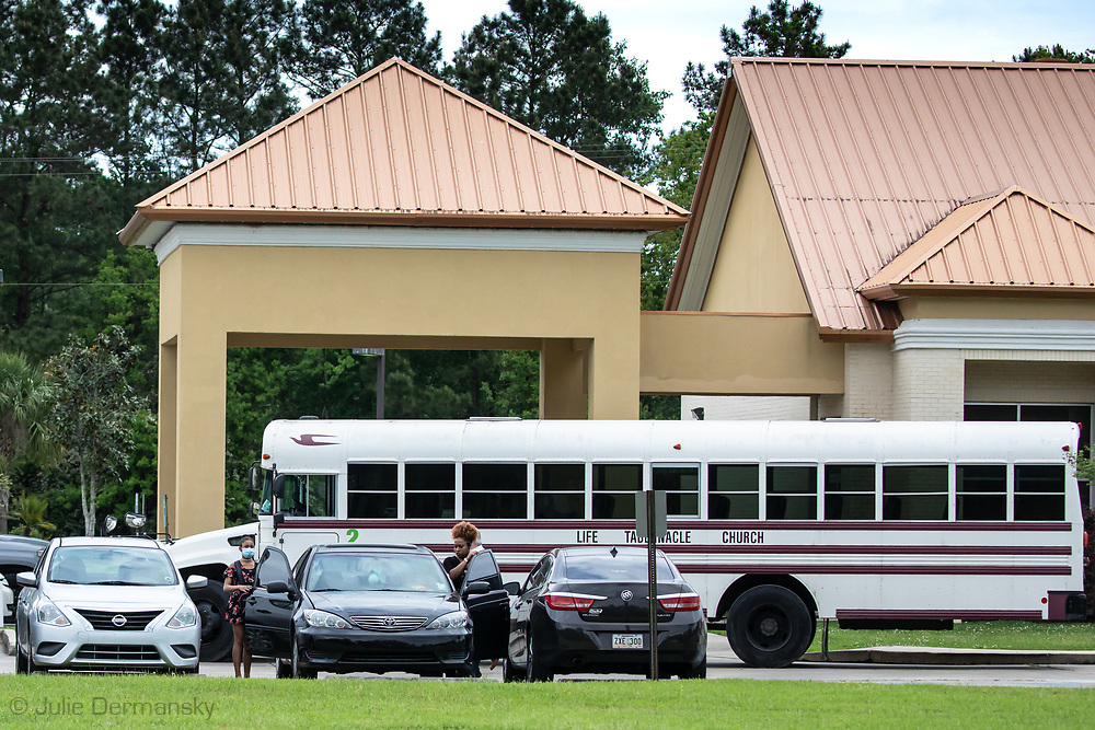 Sunday, March 29, 202, Congregants leaving the  Life Tabernacle Church after atteneding a service led by  Pastor Tony Spell  who defied Louisiana Gov. John Bel Edwards shelter-in-place order  despite the coronavirus Pandemic.