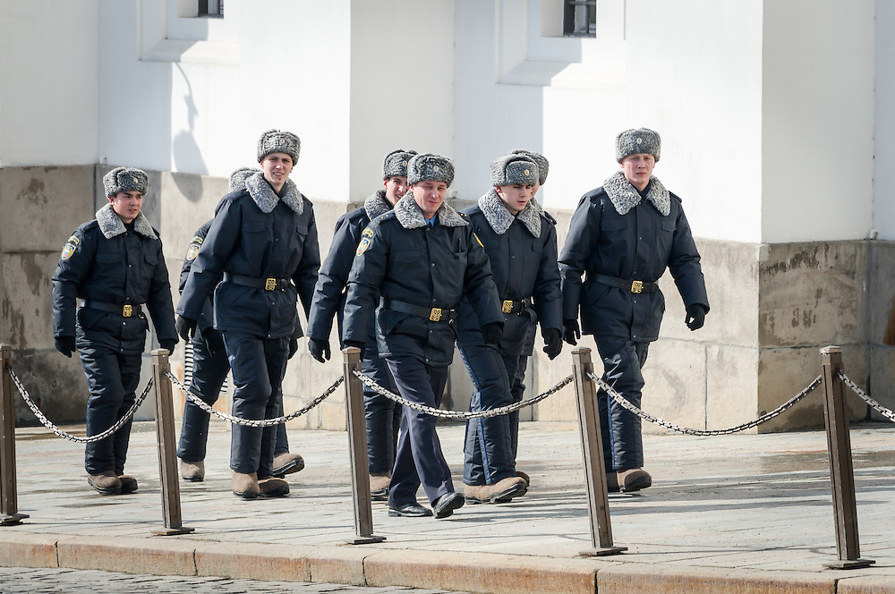MOSCOW - CIRCA MARCH 2013: Officials walking inside the Kremlin in Moscow with people in the streets, circa 2013. With a population of more than 11 million people is one the largest cities in the world and a popular tourist destination.