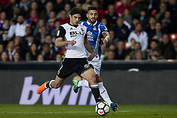 April 8, 2018 - Valencia, Valencia, Spain - Guedes (L) of Valencia CF competes for the ball with Navarro of RCD Espanyol during the La Liga game between Valencia CF and RCD Espanyol at Mestalla on April 8, 2018 in Valencia, Spain  (Credit Image: © David Aliaga/NurPhoto via ZUMA Press)
