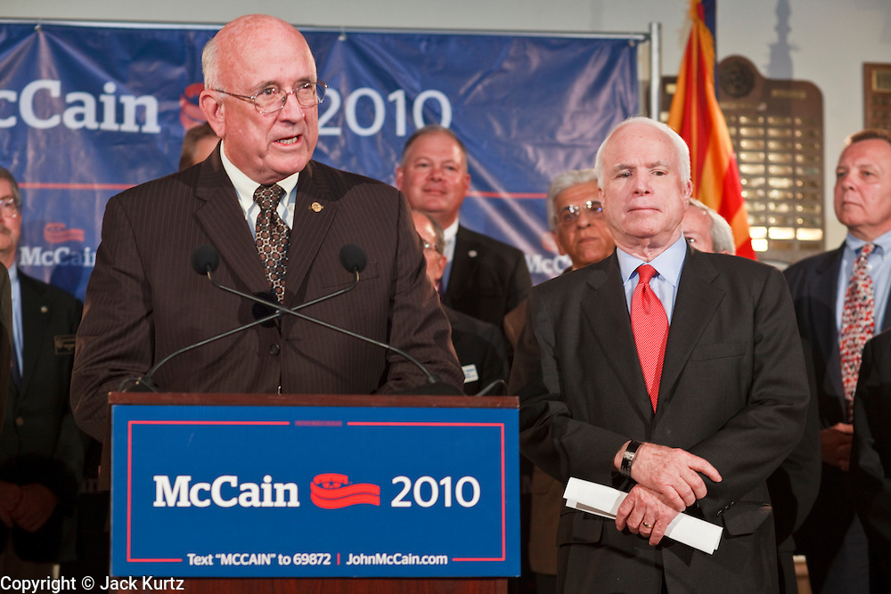 15 FEBRUARY 2010 -- TEMPE, AZ: Bob Walkup (LEFT) Mayor of Tucson, AZ, talks about Sen John McCain (RIGHT) during a press conference at American Legion Hall Post 2 in Tempe Monday morning. McCain introduced more than 30 mayors from across Arizona that have or will be endorsing him in his primary against former TV sports anchor and Congressman J.D. Hayworth. Hayworth, an arch conservative, is running against McCain for being too liberal on spending and immigration.    PHOTO BY JACK KURTZ