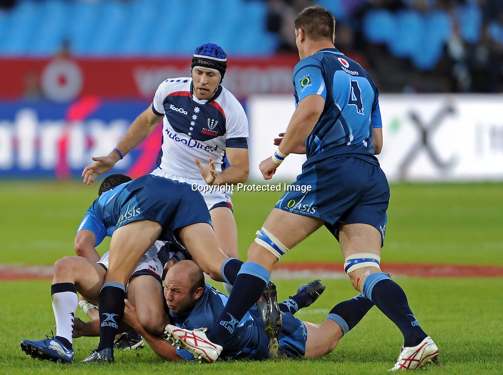 PRETORIA, South Africa, 14 May 2011. Gary Botha and Morne Steyn of the Bulls making the tackle during the Super15 Rugby match between the Bulls and the Melbourne Rebels at Loftus Versfeld in Pretoria, South Africa on 14 May 2011.<br /> Photographer : Anton de Villiers / SPORTZPICS