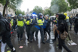 © Licensed to London News Pictures. 06/06/2020. London, UK. Police in riot gear move in to remove protesters gathered in Westminster, central London to take part in a Black Lives Matter demonstration over the killing of African American George Floyd. The death of George Floyd, who died after being restrained by a police officer In Minneapolis, Minnesota, caused widespread rioting and looting across the USA. Photo credit: Ben Cawthra/LNP