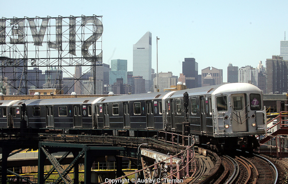 Long Island City, NY:  Friday, May 14, 2005-- The 7 subway train along it's route in Queens with the Silvercup Studio sign in the background.   ©Audrey C. Tiernan