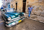 Man and old car in Havana Centro, Cuba.
