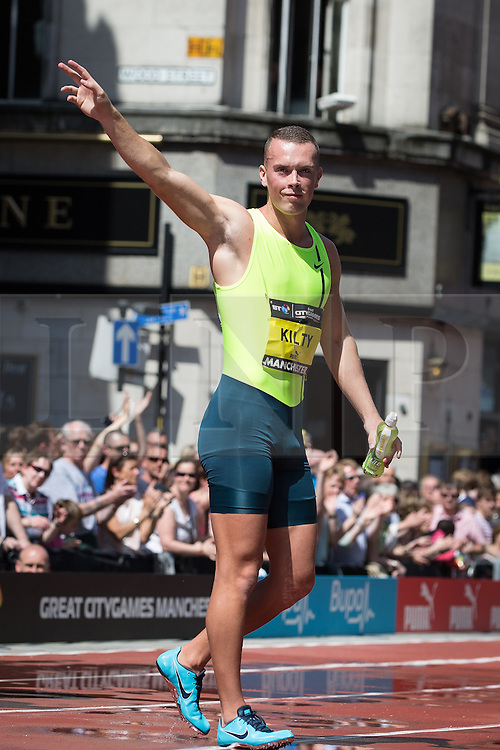 © Licensed to London News Pictures . 17/05/2014 . Manchester , UK . RICHARD KILTY . The Great City Games in Manchester , with athletics on a track along Deansgate and Pole Vault and Long Jump in Albert Square . Photo credit : Joel Goodman/LNP