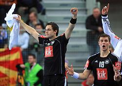 Michael Muller (6) and Michael Kraus (18) of Germany celebrate during 21st Men's World Handball Championship preliminary Group C match between FYR Macedonia and Germany, on January 21, 2009, in Arena Varazdin, Varazdin, Croatia. (Photo by Vid Ponikvar / Sportida)