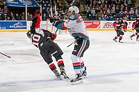 KELOWNA, CANADA - MARCH 1: Josh Curtis #10 of the Prince George Cougars is checked James Hilsendager #2 of the Kelowna Rockets during first period on MARCH 1, 2017 at Prospera Place in Kelowna, British Columbia, Canada.  (Photo by Marissa Baecker/Shoot the Breeze)  *** Local Caption ***
