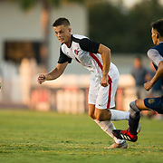 09 September 2018: San Diego State Aztecs midfielder Emil Kjellker (6) dribbles past a UC Irvine defender late in the second half. The San Diego State men's soccer team beat UC Irvine in overtime 2-1 Sunday afternoon at the SDSU Sports Deck.