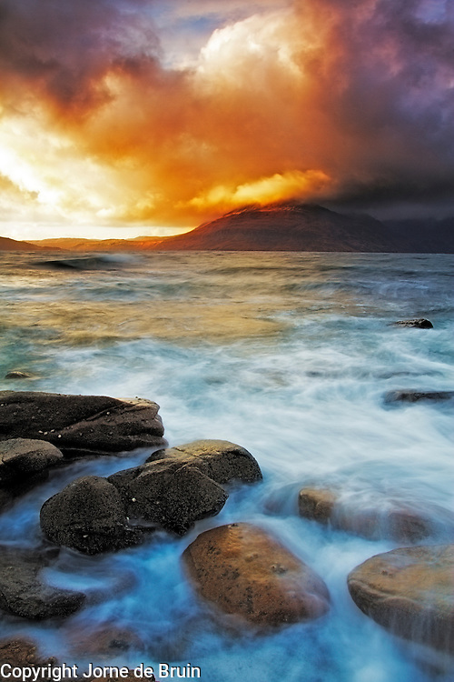 Sunset over the Cuillin Mountains as seen from the rocky shore of Elgol, Isle of Skye