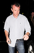 15.JUNE.2009.LONDON<br /> <br /> GUY RITCHIE INSIDE HIS PUB THE PUNCHBOWL MAYFAIR SAYING BYE TO TWO WOMEN WITH ONE OF THEM COVERING HER FACE AS SHE LEFT WITH GUY TURNING HIS BACK AS THE WOMEN WALKED DOWN THE ROAD THEY KEPT COVERING THERE FACES, THE ONE WITH SHORT HAIR COVERING HER FACE IS MRS BARCLAYS DAUGHTER, GUY STAYED IN FOR ANOTHER HOUR AND LEFT AT 2.00AM LOOKING VERY SCRUFFY  WITH HIS SHIRT HANGING OUT.<br /> <br /> BYLINE MUST READ: EDBIMAGEARCHIVE.COM<br /> <br /> *THIS IMAGE IS STRICTLY FOR UK NEWSPAPERS AND MAGAZINES ONLY* <br /> *FOR WORLDWIDE SALES AND WEB USE PLEASE CONTACT EDBIMAGEARCHIVE - 0208 954 5968*