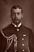 George V (1865-1935) King of Great Britain and Ireland from 1910. Here before the death of his grandmother Queen Victoria, when he was known as Prince George of Wales.   From 'The Cabinet Portrait Gallery' (London, 1890-1894).  Woodburytype after photograph by W & D Downey.