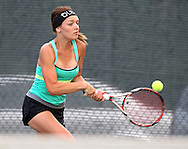 Iowa City West's Addy Riley returns the ball during the Class 2A state team tennis tournament at Veterans Memorial Tennis Center in Cedar Rapids on Saturday, June 1, 2013.