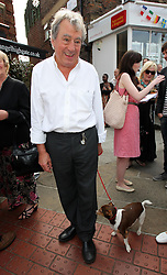 Terry Jones and his dog Nancy  at the unveiling of a  blue plaque dedicated to former Monty Python Graham Chapman at his local pub the Angel in Highgate, North London, Thursday, 6th September 2012  Photo by: Stephen Lock / i-Images