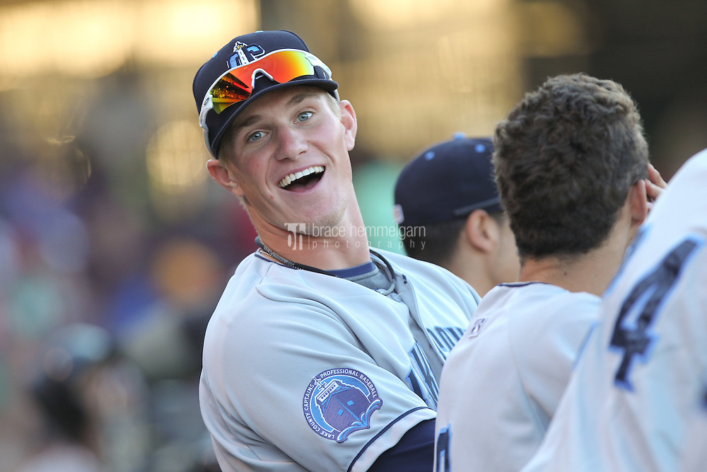 Lake County Captains outfielder Jordan Smith #39 smiles in the dugout during a game against the Dayton Dragons at Fifth Third Field on June 25, 2012 in Dayton, Ohio. Lake County defeated Dayton 8-3. (Brace Hemmelgarn)