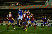 Danny Hollands wins a header during the The FA Cup match between Aldershot Town and Portsmouth at the EBB Stadium, Aldershot, England on 19 November 2014.