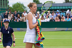 LONDON, ENGLAND - Tuesday, June 28, 2016: Kristyna Pilskovia (CZE) wipes her racquet with a Wimbledon towel during the Ladies' Singles 1st Round match on day two of the Wimbledon Lawn Tennis Championships at the All England Lawn Tennis and Croquet Club. (Pic by Kirsten Holst/Propaganda)