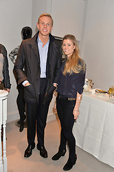 JAMES OSBORNE and SARAH BOYD at a party at Herve Leger, Lowndes Street, London on 12th November 2014 to view the latest collection.