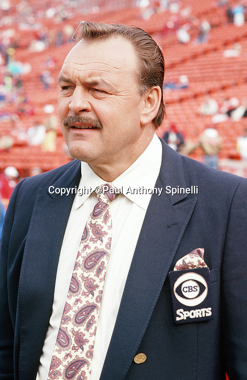 Sports analyst Dick Butkus watches pregame warmups before the San Francisco 49ers NFL NFC Championship playoff football game against the Los Angeles Rams on Jan. 14, 1990 in San Francisco. The 49ers won the game 30-3. (©Paul Anthony Spinelli)