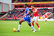 Donervon Daniels of Wigan Athletic holds off Milan Lalkovič of Walsall FC during the Sky Bet League 1 match between Walsall and Wigan Athletic at the Banks's Stadium, Walsall, England on 20 February 2016. Photo by Mike Sheridan.