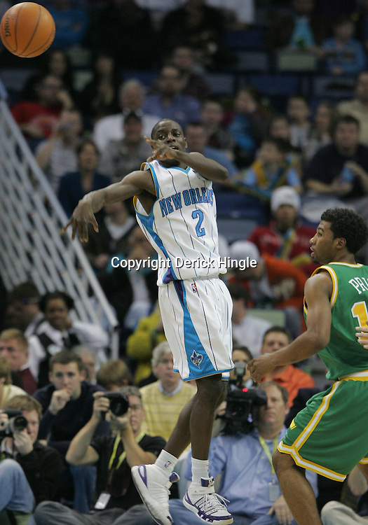 Feb 17, 2010; New Orleans, LA, USA; New Orleans Hornets guard Darren Collison (2) passes away the ball as Utah Jazz guard Ronnie Price (17) defends the play during the third quarter at the New Orleans Arena. The Jazz defeated the Hornets 98-90. Mandatory Credit: Derick E. Hingle-US PRESSWIRE