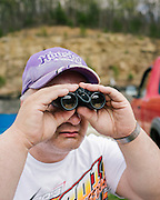Ronald Halberstadt reviews the car haulers pulling into 201 Speedway near Paintsville, Kentucky, before the start of a Spring National Series event on Thursday, April 18, 2013. <br /> <br /> Photo by D.L. Anderson for ESPN: The Magazine