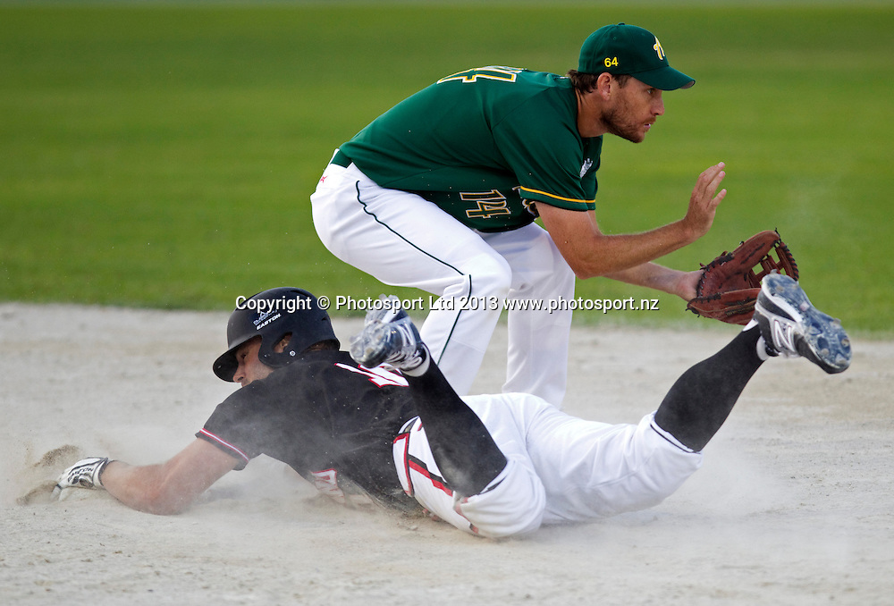 New Zealand's captain Rhys Casley dives at the base as Australia's Nathan Jones fields in the World Mens Softball Championships New Zealand v Australia at Rosedale Park, Albany, Auckland, New Zealand, Friday, March 08, 2013. Photo: David Rowland/Photosport