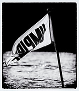 "Putney, Greater London, ENGLAND, 5th March 2006, Umpire's flag, hanging from the back of the umpires launch, at a Pre 2006 Boat Race Fixture running up to, ""The Annual Boat-race"",    ""Film Noir Style Photography"", © Peter SPURRIER,"