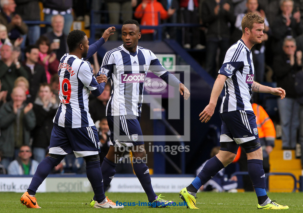 Saido Berahino (centre) of West Bromwich Albion celebrates scoring his sides first goal with his team mates during the Barclays Premier League match at The Hawthorns, West Bromwich<br /> Picture by Tom Smith/Focus Images Ltd 07545141164<br /> 26/04/2014