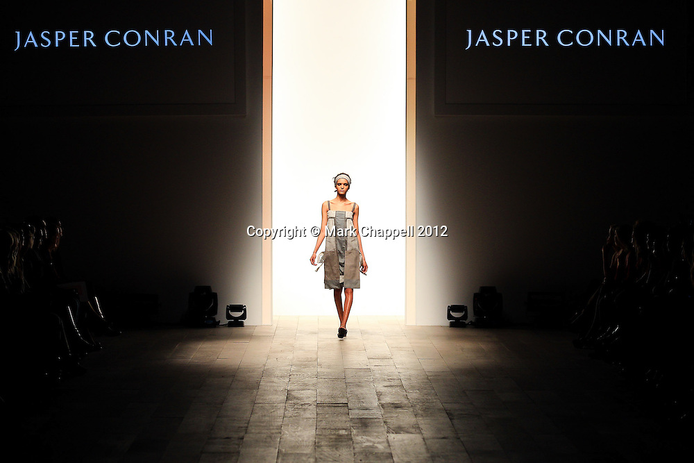 LONDON, UNITED KINGDOM. February 23 2012. The Jasper Conran SS12 Collection on display at London Fashion Weekend, sponsored by Vodafone and Canon. Held at Somerset House, London.<br /> Photo Credit: Mark Chappell<br /> &copy; Mark Chappell 2012. All Rights Reserved. See instructions.