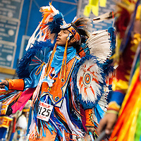 11031313    Brian Leddy<br /> Darnell Johnson dances during a powwow Friday night in Ft. Defiance. The powwow was held in honor of Sister Marquerite Bartz.