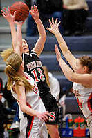 Priest River High's Steffie Pavey goes up for a fade-away jump shot between two Fruitland High defenders during the 3A state basketball consolation championship game Saturday in Nampa.