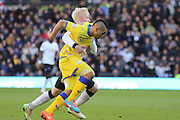 Derby County midfielder Will Hughes (19) pulls back Sheffield Wednesday midfielder Lewis McGugan (37) during the Sky Bet Championship match between Derby County and Sheffield Wednesday at the iPro Stadium, Derby, England on 21 February 2015. Photo by Aaron Lupton.