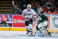 KELOWNA, CANADA - JANUARY 08: Nick Merkley #10 of Kelowna Rockets skates in front of Carter Hart #70 of Everett Silvertips on January 8, 2016 at Prospera Place in Kelowna, British Columbia, Canada.  (Photo by Marissa Baecker/Shoot the Breeze)  *** Local Caption *** Nick Merkley; Carter Hart;