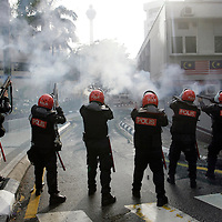 Malaysian riot police fire a tear gas during a protest in Kuala Lumpur, Malaysia 16 February 2008. Malaysian police used water tear gas and water cannon to break up an anti-government protest by ethnic Indians demanding racial equality three weeks before the country holds elections.