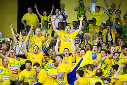 Luka Zvizej of Celje PL and other players with Florijani, fans of Celje celebrate after winning during handball match between RK Gorenje Velenje and RK Celje Pivovarna Lasko in Final match of 1st NLB League - Slovenian Championship 2013/14 on May 23, 2014 in Rdeca dvorana, Velenje, Slovenia. RK Celje Pivovarna Lasko became 18-times Slovenian National Champion. Photo by Vid Ponikvar / Sportida