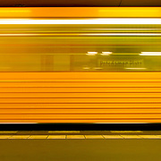 Subway train blur motion yellow, Berlin, Germany (June 2007)