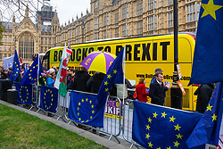 """A bus emblazoned with """"Bollocks To Brexit"""" drives past Leave and Remain demonstrators outside the Houses of Parliament in London where MPs are debating and will later vote on Prime Minister Theresa May's Brexit deal. London, January 15 2019."""