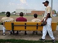 25 MAY 2010 -- FLORISSANT, Mo. -- Hazelwood Central High School baseball player Reggie Seay (17, right) waits with other players for the start of Central's game against St. Louis University High School at Hazelwood Central Tuesday, May 25, 2010. SLUH won, 12-0. Photo © copyright 2010 by Sid Hastings.