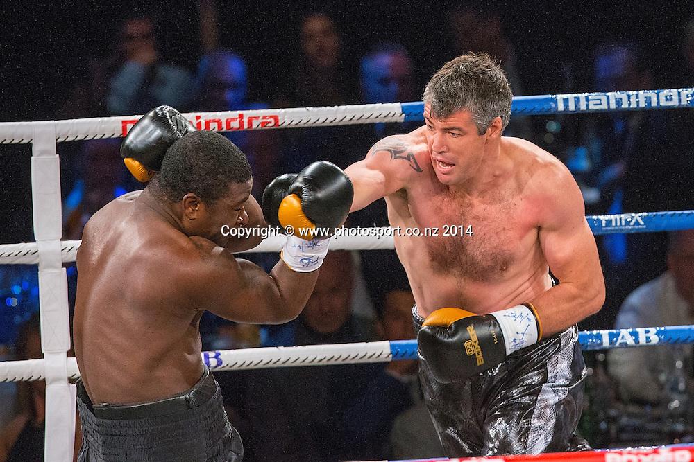 Brad `Hollywood` Pitt (R) fights Joseph Kwadjo in the Mahindra Super 8 Fight Night, North Shore Events Centre, Auckland, New Zealand, Saturday, November 22, 2014. Photo: David Rowland/Photosport