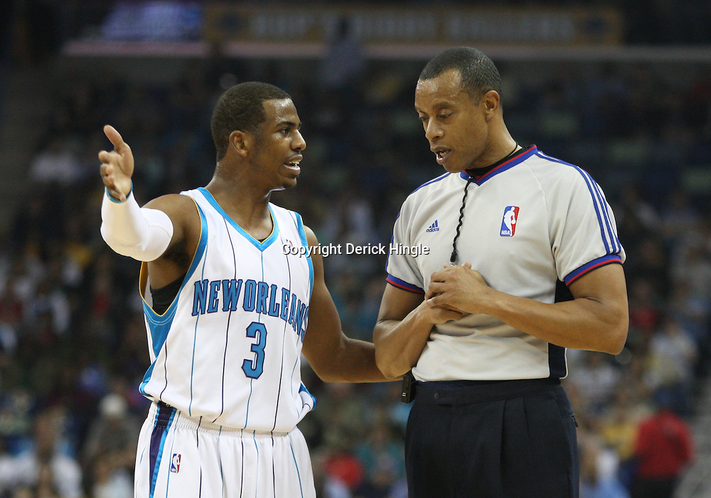 18 February 2009: New Orleans Hornets guard Chris Paul (3) discusses a foul called with NBA official  Rodney Mott during a NBA basketball game between the Orlando Magic and the New Orleans Hornets at the New Orleans Arena in New Orleans, Louisiana.