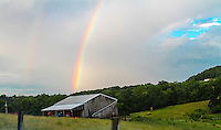 Rainbow over barn in Southeastern Ohio. Rainbow images for sale.