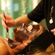 A beautiful women receives a chocolate facial at Hanmer Springs Thermal Day Spa. Hanmer Springs, South Island, New Zealand, 17th February 2011, Photo Tim Clayton