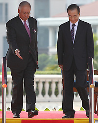 © licensed to London News Pictures. KUALA LUMPUR 28/04/11. Malaysian prime minister Najib Razak (L)  walks with Chinese Premier Wen Jiabao after inspects a guard of honour at the prime minister's office in Putrajaya outside Kuala Lumpur on April 28, 2011.Wen began a two-day visit to Malaysia to reaffirm relations and boost economic ties between the two countries. Please see special instructions for usage rates. Photo credit should read Mohd Rasfan/LNP