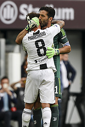 May 19, 2018 - Turin, Italy - Juventus goalkeeper Gianluigi Buffon (1) greets Juventus midfielder Claudio Marchisio (8) during his last football match JUVENTUS - VERONA on 19/05/2018 at the Allianz Stadium in Turin, Italy. (Credit Image: © Matteo Bottanelli/NurPhoto via ZUMA Press)