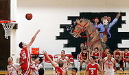 The Premont Cowboys and Brownsville's IDEA Frontier Academy players scramble to get a rebound Tuesday, Feb. 14, 2012 during Premont's final basketball game of the season. The game marked Premont's last sporting event for at least a year. Superintendent Ernest Singleton made the decision to suspend the sports program, cutting football, baseball and all other spring sports once the basketball season ended. The move, he said, would help the district with their troubled finances, once of the major factors in the state's decision to seek closure.
