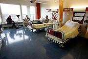 The Hague. Hospital. MCH. Medisch Centrum Haaglanden. People in their hospital room. Photo: Gerrit de Heus