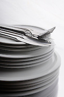 Cutlery on stack of plates